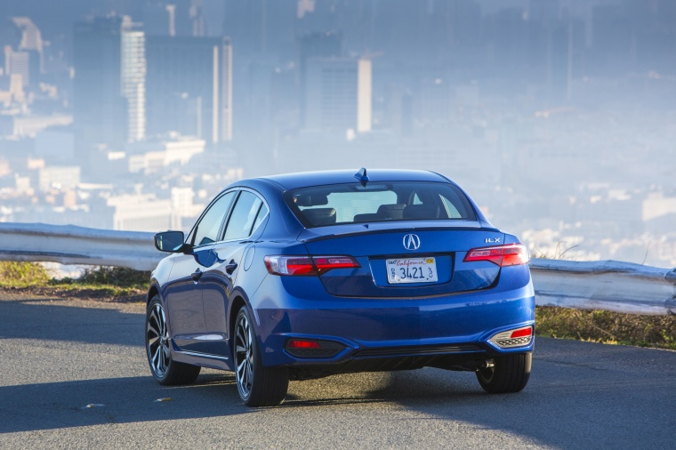 Driving 2018 Acura ILX Sedan in Blue from a rear view
