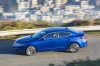 Driving 2018 Acura ILX Sedan in Blue from a side view