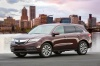 2016 Acura MDX in Dark Cherry Pearl from a front left three-quarter view