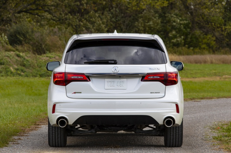 Picture of a 2019 Acura MDX A-Spec in White Diamond Pearl from a rear perspective