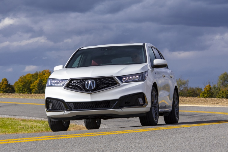 Picture of a driving 2019 Acura MDX A-Spec in White Diamond Pearl from a front left perspective