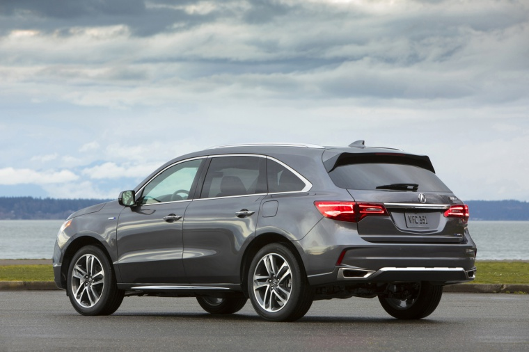 Picture of a 2019 Acura MDX Sport Hybrid in Modern Steel Metallic from a rear left three-quarter perspective