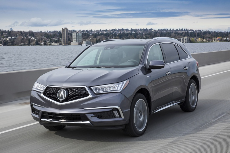 Picture of a driving 2019 Acura MDX Sport Hybrid in Modern Steel Metallic from a front left perspective