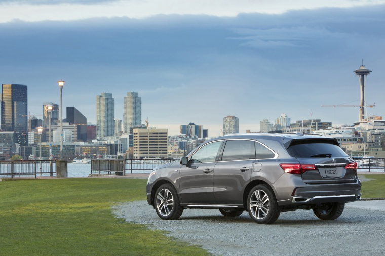 Picture of a 2019 Acura MDX Sport Hybrid in Modern Steel Metallic from a rear left perspective