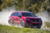 Picture of a driving 2019 Acura MDX A-Spec in Performance Red Pearl from a front right perspective