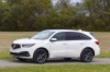 Picture of a 2019 Acura MDX A-Spec in White Diamond Pearl from a front left three-quarter perspective