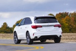Picture of a driving 2019 Acura MDX A-Spec in White Diamond Pearl from a rear left perspective