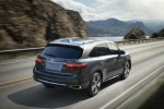 Picture of a driving 2019 Acura MDX in Modern Steel Metallic from a rear right perspective
