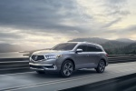 Picture of a driving 2019 Acura MDX in Modern Steel Metallic from a front left perspective