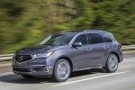 Picture of a driving 2019 Acura MDX Sport Hybrid in Modern Steel Metallic from a front left three-quarter perspective