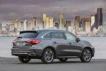 Picture of a 2019 Acura MDX Sport Hybrid in Modern Steel Metallic from a rear right three-quarter perspective