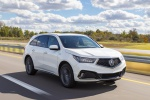 Picture of a driving 2019 Acura MDX A-Spec in White Diamond Pearl from a front right perspective