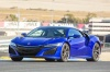 Driving 2018 Acura NSX Sport Hybrid SH-AWD in Nouvelle Blue Pearl from a front left three-quarter view