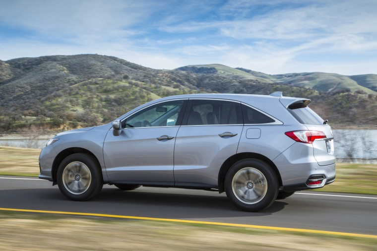 Driving 2017 Acura RDX AWD in Lunar Silver Metallic from a rear left three-quarter view