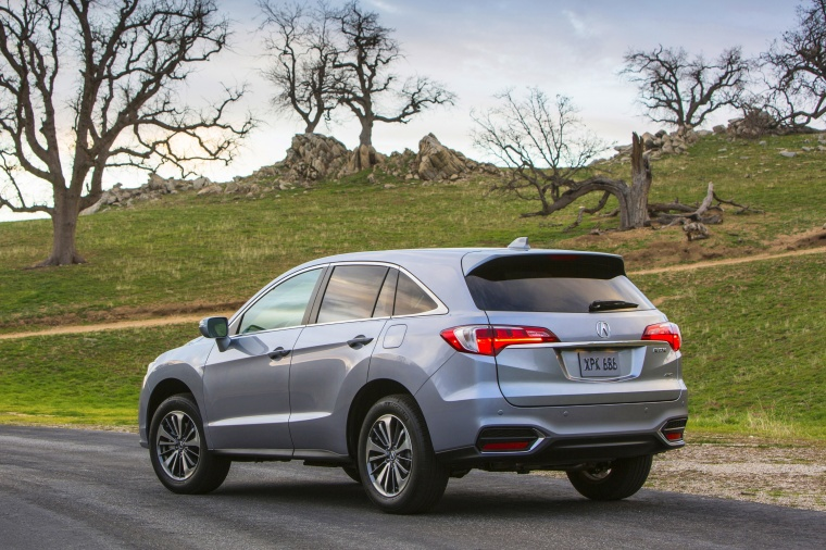 2017 Acura RDX AWD in Lunar Silver Metallic from a rear left view