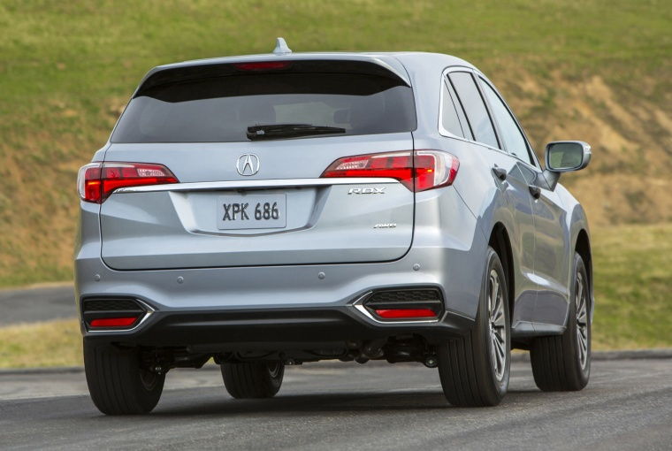 Driving 2017 Acura RDX AWD in Lunar Silver Metallic from a rear right view