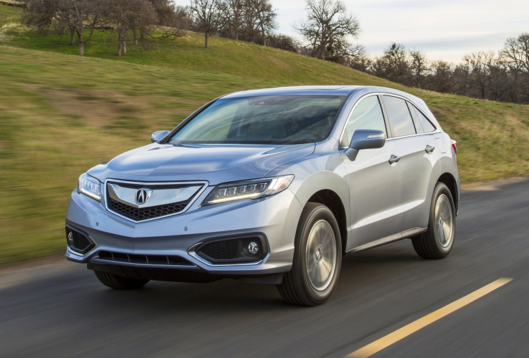 Driving 2017 Acura RDX AWD in Lunar Silver Metallic from a front left view