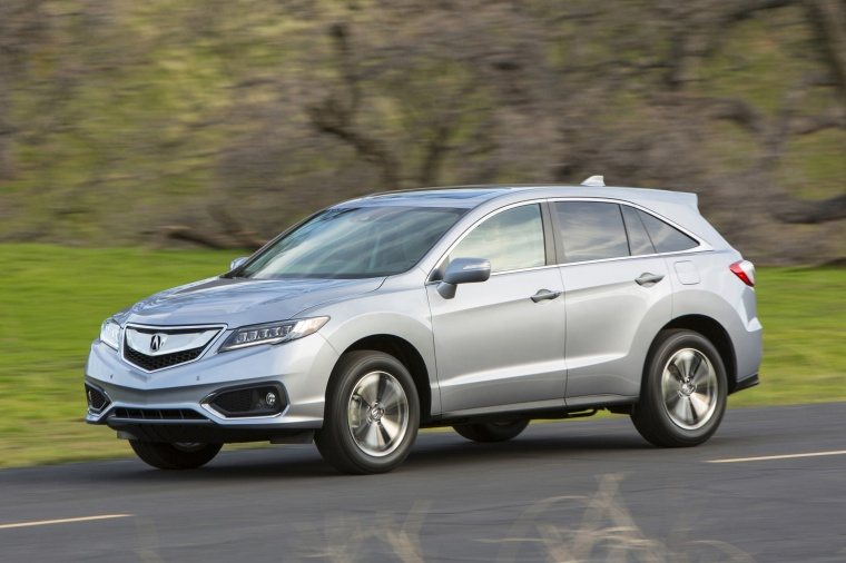 Driving 2017 Acura RDX AWD in Lunar Silver Metallic from a front left three-quarter view