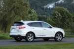 Picture of a 2020 Acura RDX SH-AWD in Platinum White Pearl from a rear right three-quarter perspective