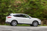 Picture of a driving 2020 Acura RDX SH-AWD in Platinum White Pearl from a right side perspective