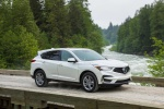 Picture of a driving 2020 Acura RDX SH-AWD in Platinum White Pearl from a front right three-quarter perspective