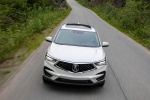 Picture of a driving 2020 Acura RDX SH-AWD in Platinum White Pearl from a frontal perspective