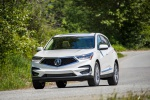 Picture of a driving 2020 Acura RDX SH-AWD in Platinum White Pearl from a front left perspective