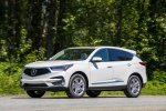 Picture of a driving 2020 Acura RDX SH-AWD in Platinum White Pearl from a front left three-quarter perspective