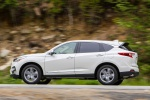 Picture of a driving 2020 Acura RDX SH-AWD in Platinum White Pearl from a left side perspective