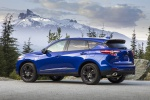 Picture of a 2020 Acura RDX A-Spec Package SH-AWD in Apex Blue Pearl from a rear left three-quarter perspective
