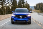 Picture of a driving 2020 Acura RDX A-Spec Package SH-AWD in Apex Blue Pearl from a frontal perspective