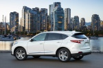 Picture of a 2020 Acura RDX SH-AWD in Platinum White Pearl from a rear left three-quarter perspective