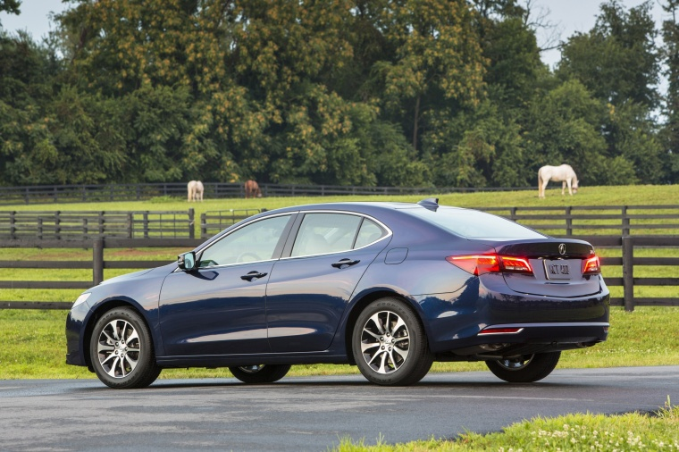 2017 Acura TLX in Fathom Blue Pearl from a rear left three-quarter view
