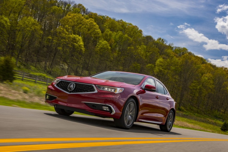 Driving 2018 Acura TLX Sedan in San Marino Red from a front left three-quarter view