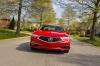 Driving 2018 Acura TLX Sedan in San Marino Red from a frontal view