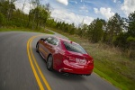 2018 Acura TLX Sedan in San Marino Red - Driving Rear Left View