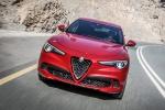Picture of a driving 2019 Alfa Romeo Stelvio Quadrifoglio AWD in Rosso Competizione Tri-Coat from a frontal perspective