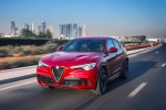 Picture of a driving 2019 Alfa Romeo Stelvio Quadrifoglio AWD in Rosso Competizione Tri-Coat from a front left perspective