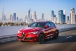 Picture of a driving 2019 Alfa Romeo Stelvio Quadrifoglio AWD in Rosso Competizione Tri-Coat from a front left three-quarter perspective