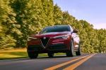 Picture of a driving 2019 Alfa Romeo Stelvio Ti Sport AWD in Rosso Competizione Tri-Coat from a front left perspective