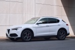 Picture of a 2019 Alfa Romeo Stelvio Ti Lusso AWD in Alfa White from a front left three-quarter perspective