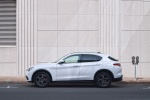 Picture of a 2019 Alfa Romeo Stelvio Ti Lusso AWD in Alfa White from a side perspective