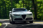 Picture of a driving 2019 Alfa Romeo Stelvio Ti Lusso AWD in Alfa White from a front right perspective