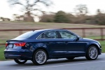 2015 Audi A3 2.0T quattro Sedan in Scuba Blue Metallic - Driving Rear Right Three-quarter View