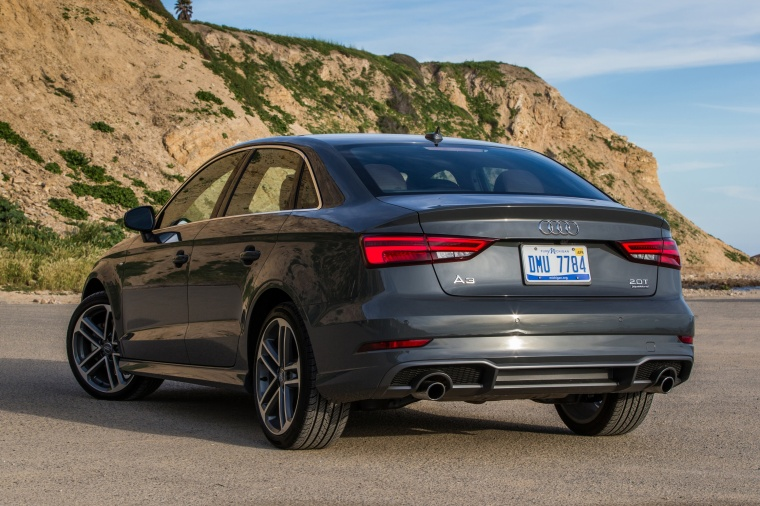 2018 Audi A3 2.0T S-Line quattro Sedan in Monsoon Gray Metallic from a rear left view