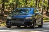 Driving 2018 Audi S3 Sedan in Navarra Blue Metallic from a front left view