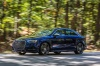 Driving 2018 Audi S3 Sedan in Navarra Blue Metallic from a front left three-quarter view