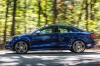 Driving 2018 Audi S3 Sedan in Navarra Blue Metallic from a left side view