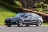 Driving 2018 Audi A3 2.0T S-Line quattro Sedan in Monsoon Gray Metallic from a front left three-quarter view