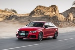 2018 Audi RS3 Sedan in Catalunya Red Metallic - Driving Front Left Three-quarter View